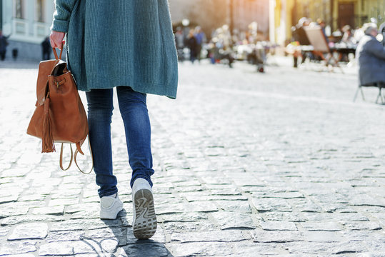Girl going in city with backpack