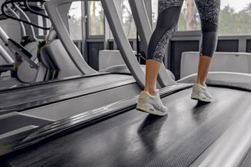 Female going on equipment in fitness center