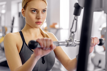 Calm woman working out on equipment
