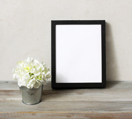 Blank frame mockup with fresh white flowers