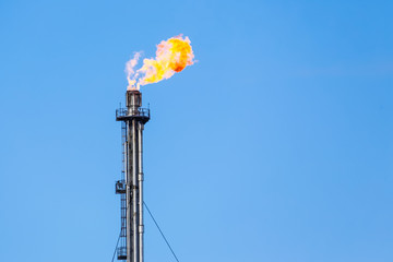 Refinery flare - Burning of dangerous gases in the oil field.