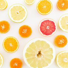 Food pattern of fresh citrus on white background. Flat lay, top view.