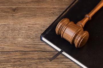 Judge hammer lies on book