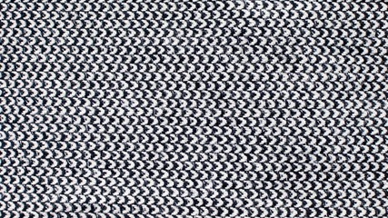 Grey woolen or tweed fabric for grunge background. Toned image.
