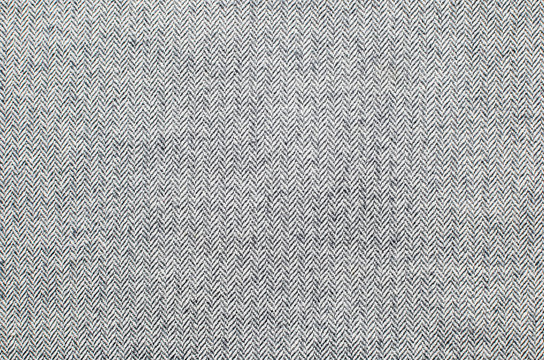 Light grey woolen or tweed fabric for grunge background