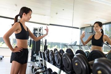 Sport woman taking selfie in gym