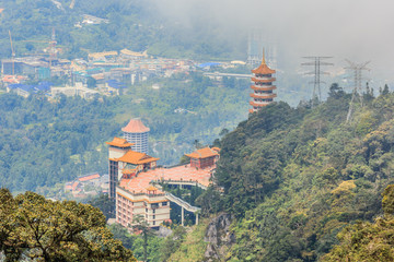 Chin Swee Cave Temple in Genting Highlands overlooking from viewpoint of Theme park hotel in the background
