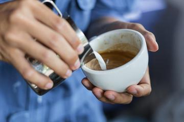barista make latte art selective  focus