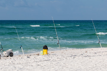Fishing poles at the beach in the Gulf of Mexico.