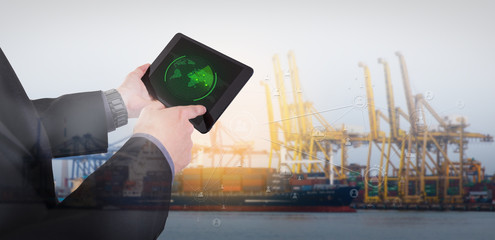 Hand presses on tablet with radar targets in action,  Logistics Import Export background (Elements of this image furnished by NASA)