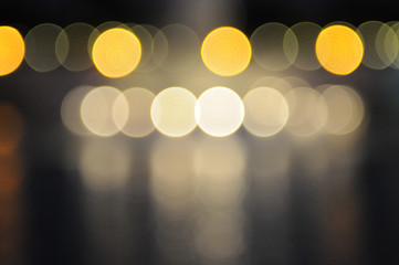 Lights blurred bokeh background from night party for your design, vintage or retro color toned