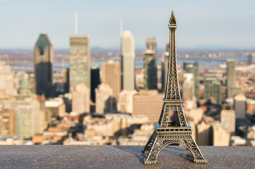 Eiffel tower miniature and Montreal skyline in the background