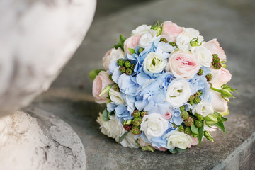 delicate bouquet of roses and hydrangeas