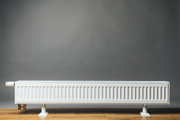 heating radiator on grey background