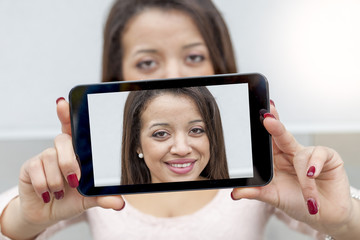 african american pretty woman take a selfie with smart phone