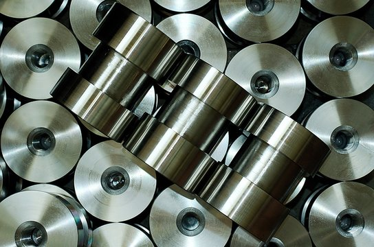 Products of CNC machining. Round parts with a threade just produced by lathe tourning. View from above.