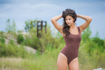 Fitness beautiful slim girl with brown hair posing
