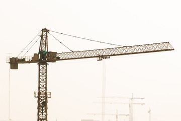 Heavy power crane working a construction.