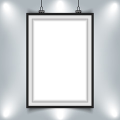 modern picture frame hanging on wall with spotlight