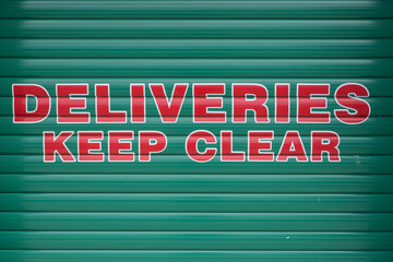 Deliveries keep clear sign on shuttered door