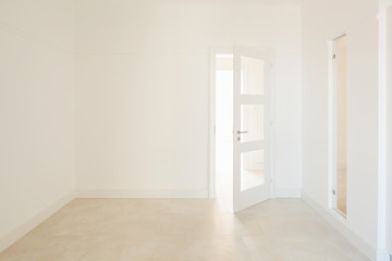 White room with door, nobody inside
