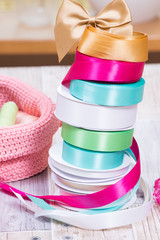 Colorful baskets, tapes and laces, and other tools for scrapbooking and handmade