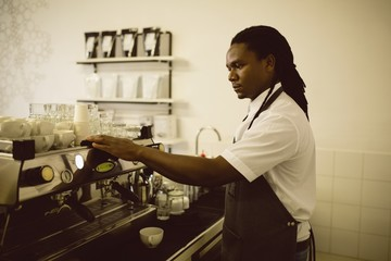 Man preparing coffee in the coffee shop