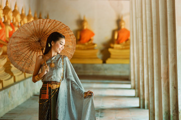Asian woman wearing traditional thai culture,vintage style,Thailand culture,Thailand traditional suit,Thailand vintage,thailand woman,Thailand dress,Thailand