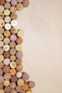 Wine corks on paper background for your text. Wall of many different wine corks with space for text. Closeup of wine corks with blurred background. Close up of cork wine on brown paper background.