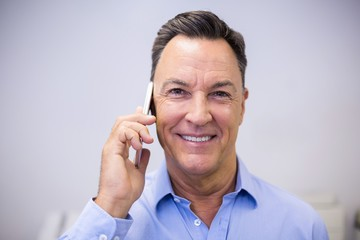 Dentist talking on mobile phone