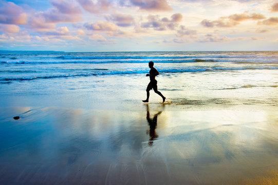 Jogging at the ocean beach