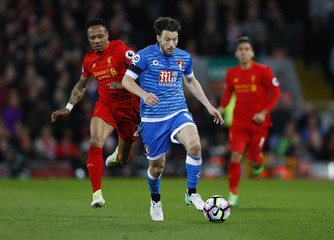 Bournemouth's Harry Arter in action with Liverpool's Nathaniel Clyne