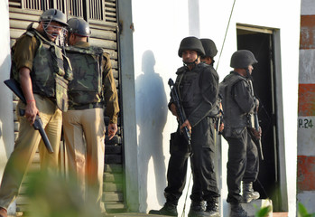 ATS commandos stand guard outside a house where a suspected militant is said to be hiding in Thakurganj area in Lucknow