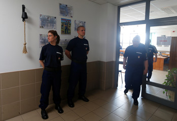 Hungarian border hunter recruits come out from the classroom during a training at the border crossing point in Barcs