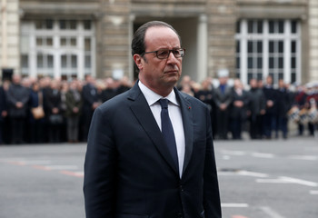 French President Francois Hollande attends a ceremony to pay tribute to Xavier Jugele, the French police officer killed on the Champs Elysees avenue during last week's shooting incident, at the Police Prefecture in Paris