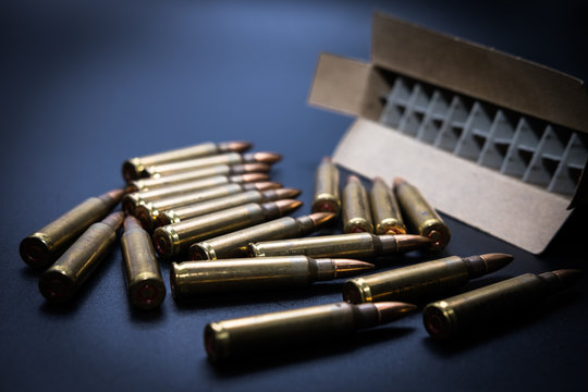 5.56  rounds and box on black background