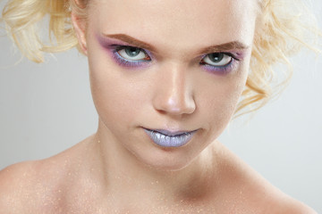 Close up portrait of a girl looking under the eye. Perfect creative make up and sequins