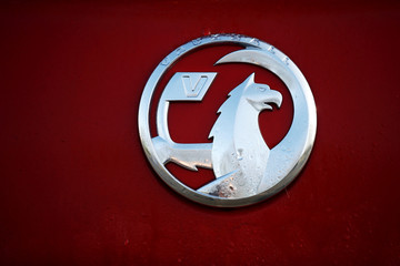 Rain is seen on the badge of a Vauxhall car parked outside Vauxhall's plant in Ellesmere Port