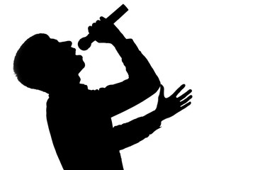 Silhouette of a singer with microphone