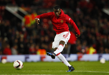 Manchester United's Paul Pogba warms up before the match