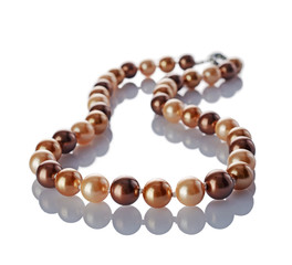 Luxury elegant golden pearl necklace close-up