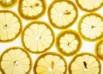 Bright citrus lemon slices on white