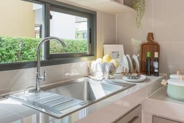 stainless steel sink with faucet on kitchen counter