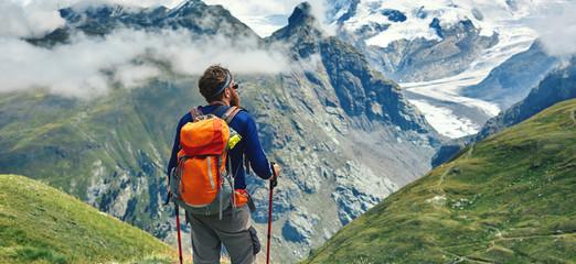 hiker on the trail in the Apls mountains. Trek near Matterhorn mount. Mountain ridge on the background Wall mural