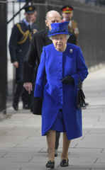 Britain's Queen Elizabeth and Prince Philip attend the unveiling on the new memorial to members of the armed services who served and died in the wars in Iraq and Afghanistan, in London