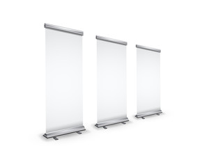 Three blank realistic roll-up banners with shadow in perspective view on white
