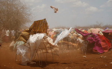 A dust storm sweeps through a makeshift camps in Baidoa, west of Somalia's capital Mogadishu