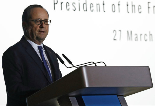 French President Hollande speaks during a public lecture in Singapore