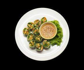 Thai fresh spring rolls on black background