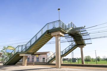 metal footbridge passes over the railway track train